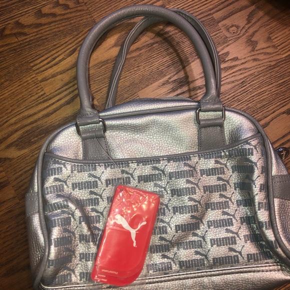 Puma Handbags - Nwt silver puma purse